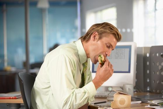 Businessman eating lunch at desk